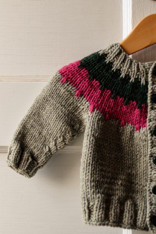Cogwheel Baby Cardigan Knitting Pattern: Sleeve close-up